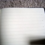 notebook-with-dots-on-lines